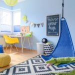 Shot of a modern colorful children's room with a hanging chair