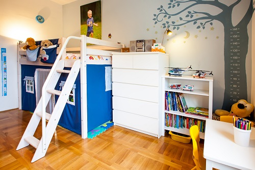 Boy room with house playground and tree with lost of toys