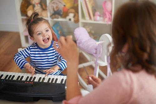 Young girl playing keyword
